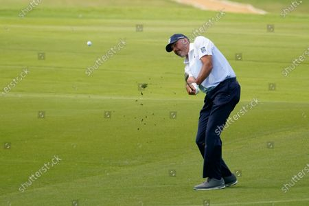 Matt Kuchar hits to the 18th green during the third round of the AT&T Byron Nelson golf tournament, in McKinney, Texas