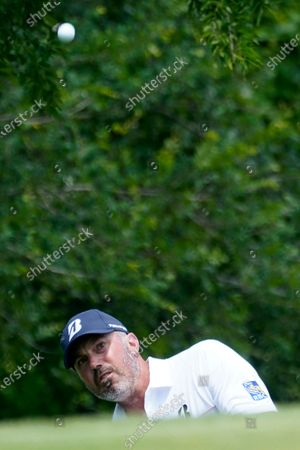 Matt Kuchar chips onto the first green during the third round of the AT&T Byron Nelson golf tournament, in McKinney, Texas