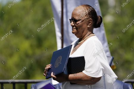 Nerene Gibbs Wray, sister of Phillip Gibbs, a Jackson State student who was shot to death by white lawmen May 15, 1970 on the campus, holds a honorary doctorate of humane letters, awarded him on the historically black campus in Jackson, Miss. A special ceremony was held 51 years after the school canceled its 1970 graduation ceremony after white law enforcement officers marched onto campus near the end of the spring semester and violently suppressed protests against racism with gunfire, killing Gibbs and James Earl Green, a high school student and wounding 12