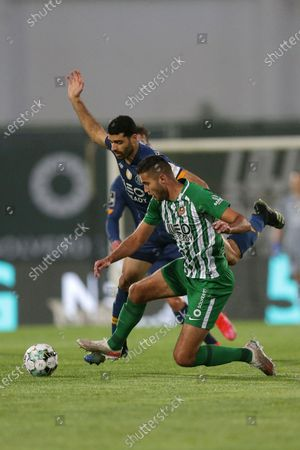 Stock Photo of Rio Ave's Toni Borevkovic (R) in action against FC Porto's Mehdi Taremi (L) during the Portuguese First League soccer match between Rio Ave and FC Porto at Rio Ave Futebol Clube stadium in Vila do Conde, Portugal, 15 May 2021.