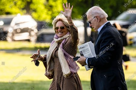 Stock Image of First lady Dr. Jill Biden waves as she walks with United States President Joe Biden to Marine One on the Ellipse near the White House in Washington, D.C., U.S.,. Biden rescinded several executive actions on Friday that were put in place by Donald Trump, including one targeting social media companies that his predecessor had ordered after Twitter fact-checked his tweets.