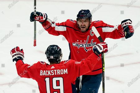 Stock Image of Washington Capitals left wing Alex Ovechkin (8) and center Nicklas Backstrom (19) celebrate after a goal during the second period of Game 1 of an NHL hockey Stanley Cup first-round playoff series against the Boston Bruins, in Washington. It was later determined that the goal was scored by Capitals defenseman Brenden Dillon