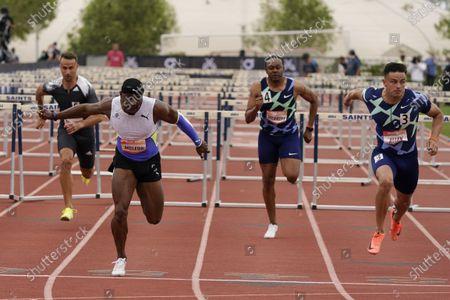 Omar McLeod, left, beats Devon Allen, right, to win the 110-meter hurdles during the Sound Running Track Meet, in Irvine, Calif