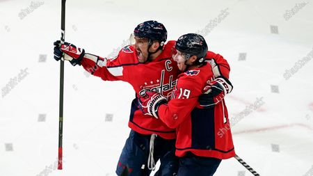 Washington Capitals left wing Alex Ovechkin (8) and Washington Capitals center Nicklas Backstrom (19) celebrate during the second period of Game 1 of an NHL hockey Stanley Cup first-round playoff series against the Boston Bruins, in Washington