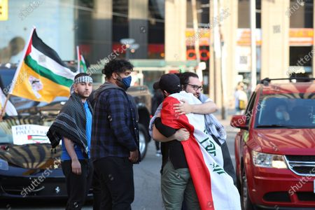 Thousand people protest in downtown Toronto, Canada on May 15, 2021 in solidarity with Palestinians. Palestinian flags and 'free Palestine' signs filled Nathan Phillips Square as thousands gathered in support of people in Gaza affected by the conflict between Israel and Hamas.