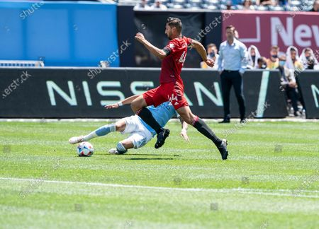Omar Gonzalez (44) of Toronto FC and Ismael Tajouri-Shradi (17) of NYCFC fight for the ball during MLS regular game on Yankees Stadium. Game ended in draw 1 - 1.
