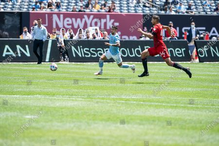 Omar Gonzalez (44) of Toronto FC and Valentin Castellanos (11) of NYCFC chase the ball during MLS regular game on Yankees Stadium. Game ended in draw 1 - 1.