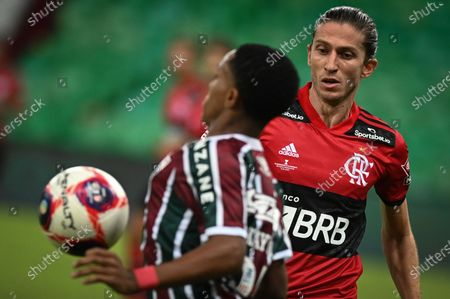 Flamengo's Filipe Luis vie for the ball with Fluminense's Kayky during a match against Fluminense, for the Carioca Championship first round final match at the Maracana Stadium in Rio de Janeiro, Brazil, on May 16, 2021.