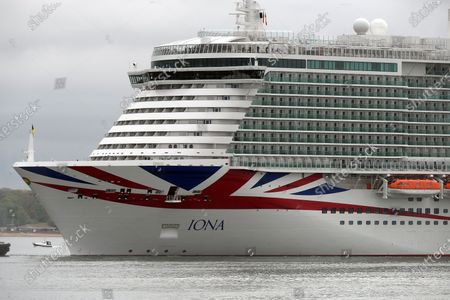 Stock Picture of P&O Cruises latest edition to the fleet Iona arrives in Southampton in heavy rain ahead of her naming ceremony today (16-05-21) by the Ships Godmother Dame Irene Hays in a virtual ceremony that will include a live performance from singer Gary Barlow and hosted by DJ and Broadcaster Jo Whiley. Dame Hays founded Hays Travel in 1980 with her husband John who died suddenly in November 2020.P&O's Iona is the largest cruise ship built for the UK market and can hold 5200 passengers and 1800 crew, she is 344m in length. She also is the first British cruise ship to be powered by Liquefied natural gas (LNG) to be the greenest ship in P&O's fleet. Her maiden voyage delayed from last year due to Covid-19 sails on August 7th on a seven day cruise to the Island of Iona and other Scottish Isles.