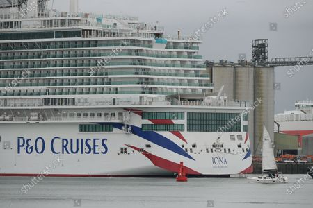 P&O Cruises latest edition to the fleet Iona arrives in Southampton in heavy rain ahead of her naming ceremony today (16-05-21) by the Ships Godmother Dame Irene Hays in a virtual ceremony that will include a live performance from singer Gary Barlow and hosted by DJ and Broadcaster Jo Whiley. Dame Hays founded Hays Travel in 1980 with her husband John who died suddenly in November 2020.P&O's Iona is the largest cruise ship built for the UK market and can hold 5200 passengers and 1800 crew, she is 344m in length. She also is the first British cruise ship to be powered by Liquefied natural gas (LNG) to be the greenest ship in P&O's fleet. Her maiden voyage delayed from last year due to Covid-19 sails on August 7th on a seven day cruise to the Island of Iona and other Scottish Isles.