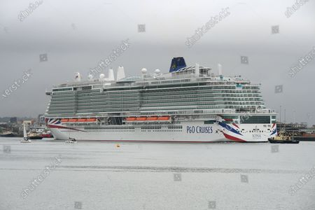Stock Photo of P&O Cruises latest edition to the fleet Iona arrives in Southampton in heavy rain ahead of her naming ceremony today (16-05-21) by the Ships Godmother Dame Irene Hays in a virtual ceremony that will include a live performance from singer Gary Barlow and hosted by DJ and Broadcaster Jo Whiley. Dame Hays founded Hays Travel in 1980 with her husband John who died suddenly in November 2020.P&O's Iona is the largest cruise ship built for the UK market and can hold 5200 passengers and 1800 crew, she is 344m in length. She also is the first British cruise ship to be powered by Liquefied natural gas (LNG) to be the greenest ship in P&O's fleet. Her maiden voyage delayed from last year due to Covid-19 sails on August 7th on a seven day cruise to the Island of Iona and other Scottish Isles.