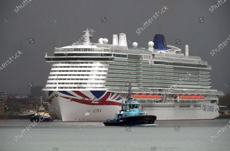 Stock Image of P&O Cruises latest edition to the fleet Iona arrives in Southampton in heavy rain ahead of her naming ceremony today (16-05-21) by the Ships Godmother Dame Irene Hays in a virtual ceremony that will include a live performance from singer Gary Barlow and hosted by DJ and Broadcaster Jo Whiley. Dame Hays founded Hays Travel in 1980 with her husband John who died suddenly in November 2020.P&O's Iona is the largest cruise ship built for the UK market and can hold 5200 passengers and 1800 crew, she is 344m in length. She also is the first British cruise ship to be powered by Liquefied natural gas (LNG) to be the greenest ship in P&O's fleet. Her maiden voyage delayed from last year due to Covid-19 sails on August 7th on a seven day cruise to the Island of Iona and other Scottish Isles.