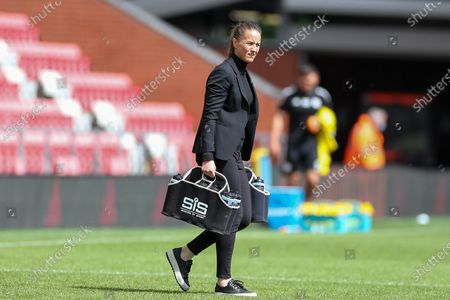 Manchester United Women Head Coach Casey Stoney carries the water out during the Women's FA Cup match between Manchester United Women and Leicester City at Leigh Sports Village, Leigh