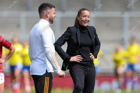 Manchester United Women Head Coach Casey Stoney enjoys a laugh in the pre match warm up during the Women's FA Cup match between Manchester United Women and Leicester City at Leigh Sports Village, Leigh