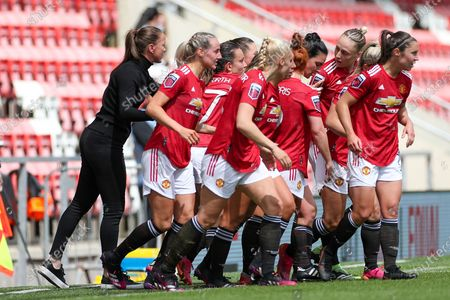 GOAL Manchester United Women Head Coach Casey Stoney celebrates with the players after Manchester United Women Forward Jess Sigsworth (9) had scored during the Women's FA Cup match between Manchester United Women and Leicester City at Leigh Sports Village, Leigh