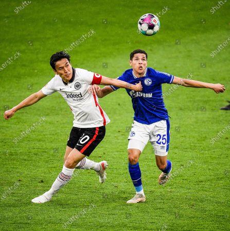 (210516) - GELSENKIRCHEN, May 16, 2021 (Xinhua) - Amine Harit (R) of Schalke 04 lives with Hasebe Makoto of Frankfurt during a German Bundesliga match between FC Schalke 04 and Eintracht Frankfurt in Gelsenkirchen, Germany, May 15, 2021.
