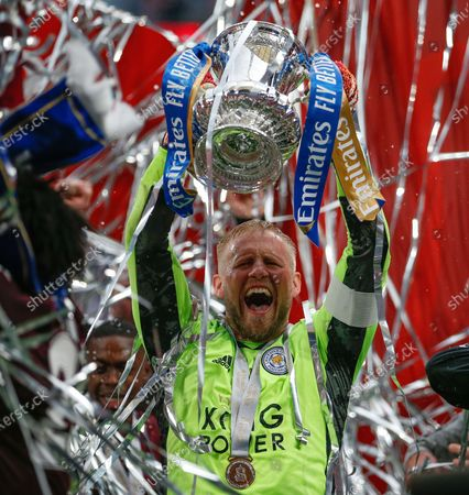 """(210516) - LONDON, May 16, 2021 (Xinhua) - Leicester City's captain Kasper Schmeichel celebrates with the trophy after the FA Cup Final match between Chelsea and Leicester City at Wembley Stadium in London, Britain, on May 15, 2021. (Photo by Matthew Impey/Xinhua)  FOR EDITORIAL USE ONLY. NOT FOR SALE FOR MARKETING OR ADVERTISING CAMPAIGNS. NO USE WITH UNAUTHORIZED AUDIO, VIDEO, DATA, FIXTURE LISTS, CLUB/LEAGUE LOGOS OR """"LIVE"""" SERVICES. ONLINE IN-MATCH USE LIMITED TO 45 IMAGES, NO VIDEO EMULATION. NO USE IN BETTING, GAMES OR SINGLE CLUB/LEAGUE/PLAYER PUBLICATIONS. - Han Yan -"""