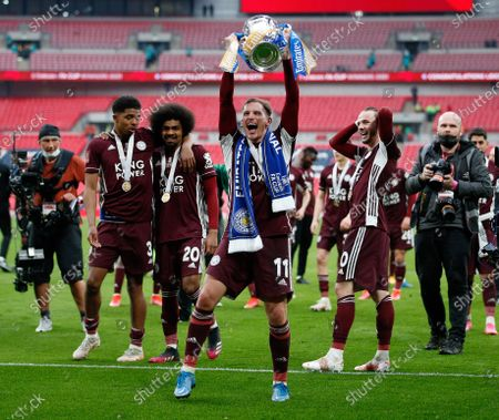"""(210516) - LONDON, May 16, 2021 (Xinhua) - Leicester City's Marc Albrighton (front) celebrates with the trophy after the FA Cup Final match between Chelsea and Leicester City at Wembley Stadium in London, Britain, on May 15, 2021. (Photo by Matthew Impey/Xinhua)  FOR EDITORIAL USE ONLY. NOT FOR SALE FOR MARKETING OR ADVERTISING CAMPAIGNS. NO USE WITH UNAUTHORIZED AUDIO, VIDEO, DATA, FIXTURE LISTS, CLUB/LEAGUE LOGOS OR """"LIVE"""" SERVICES. ONLINE IN-MATCH USE LIMITED TO 45 IMAGES, NO VIDEO EMULATION. NO USE IN BETTING, GAMES OR SINGLE CLUB/LEAGUE/PLAYER PUBLICATIONS. - Han Yan -"""