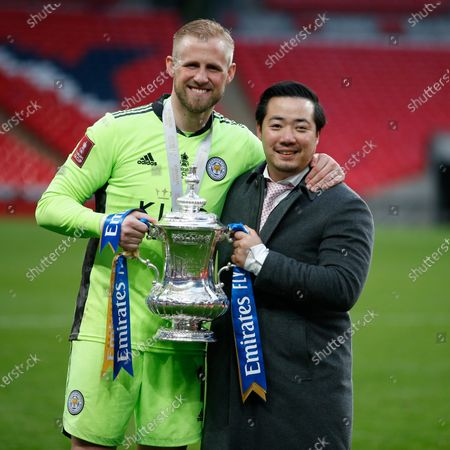 """Stock Photo of (210516) - LONDON, May 16, 2021 (Xinhua) - Leicester City Football Club chairman Aiyawatt Srivaddhanaprabha (R) and captain Kasper Schmeichel poses with the trophy after the FA Cup Final match between Chelsea and Leicester City at Wembley Stadium in London, Britain, on May 15, 2021. (Photo by Matthew Impey/Xinhua)  FOR EDITORIAL USE ONLY. NOT FOR SALE FOR MARKETING OR ADVERTISING CAMPAIGNS. NO USE WITH UNAUTHORIZED AUDIO, VIDEO, DATA, FIXTURE LISTS, CLUB/LEAGUE LOGOS OR """"LIVE"""" SERVICES. ONLINE IN-MATCH USE LIMITED TO 45 IMAGES, NO VIDEO EMULATION. NO USE IN BETTING, GAMES OR SINGLE CLUB/LEAGUE/PLAYER PUBLICATIONS. - Han Yan -"""