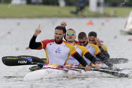Saul Craviotto, Marcus Walz, Carlos Arevalo, and Rodrigo Germade of Spain celebrate after winning the men's K4 500m final at the ICF Canoe Sprint World Cup in Szeged, Hungary, 16 May 2021.
