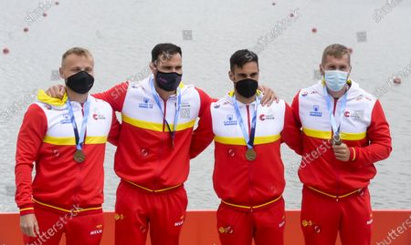 Stock Picture of Saul Craviotto, Marcus Walz, Carlos Arevalo, and Rodrigo Germade of Spain pose with their gold medals on the podium after winning the men's K4 500m final at the ICF Canoe Sprint World Cup in Szeged, Hungary, 16 May 2021.