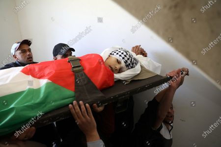 The funeral of Muhammad Yunus Freijat (15), who was killed during clashes with the Israeli army during a protest in the West Bank city of Hebron in the early morning, in Hebron, 16 May 2021. In response to days of violent confrontations between Israeli security forces and Palestinians in Jerusalem, various Palestinian militants factions in Gaza launched rocket attacks since 10 May that killed at least ten Israelis to date. According to the Palestinian Ministry of Health, at least 174 people including 47 children and 29 women have been killed in the recent retaliatory Israeli airstrikes.