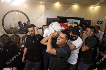 Stock Image of The funeral of Muhammad Yunus Freijat (15), who was killed during clashes with the Israeli army during a protest in the West Bank city of Hebron in the early morning, in Hebron, 16 May 2021. In response to days of violent confrontations between Israeli security forces and Palestinians in Jerusalem, various Palestinian militants factions in Gaza launched rocket attacks since 10 May that killed at least ten Israelis to date. According to the Palestinian Ministry of Health, at least 174 people including 47 children and 29 women have been killed in the recent retaliatory Israeli airstrikes.