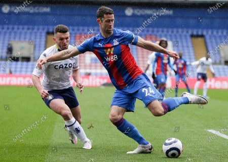 Crystal Palace's Gary Cahill, right, and Aston Villa's John McGinn battle for the ball during the English Premier League soccer match between Crystal Palace and Aston Villa at Selhurst Park in London