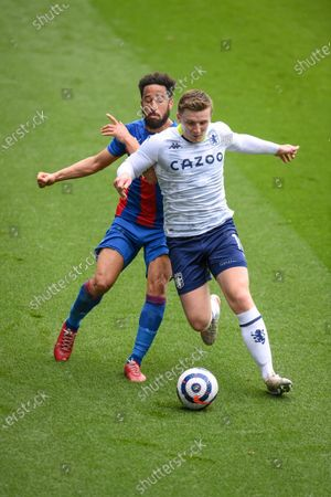 Andros Townsend (L) of Crystal Palace in action against Matt Targett (R) of Aston Villa during the English Premier League soccer match between Crystal Palace and Aston Villa in London, Britain, 16 May 2021.