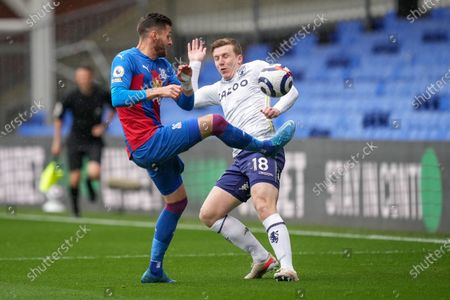 Joel Ward (L) of Crystal Palace in action against Matt Targett (R) of Aston Villa during the English Premier League soccer match between Crystal Palace and Aston Villa in London, Britain, 16 May 2021.