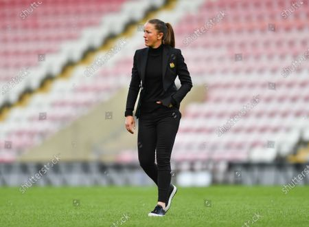 Casey Stoney (Manchester United Manager) walks around the stadium after the Womens FA Cup fifth round game between Manchester United and Leicester City at Leigh Sports Village in Leigh, England.
