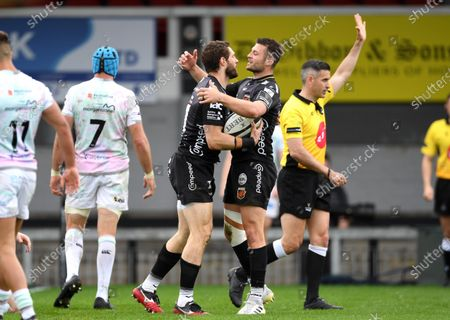 Jonah Holmes of Dragons celebrates scoring his second try with Josh Lewis.