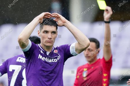 Nikola Milenkovic of ACF Fiorentina looks dejected receiving a yellow card during the Serie A match between ACF Fiorentina and SSC Napoli at Stadio Artemio Franchi, Florence, Italy on 16 May 2021.