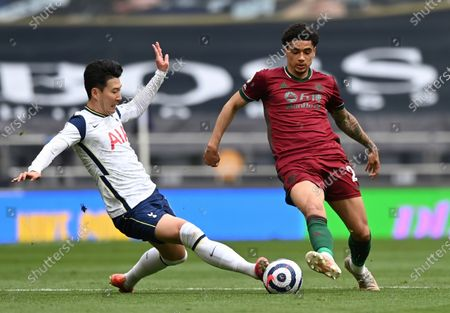 Tottenham Hotspur's Son Heung-Min, left, and Wolverhampton Wanderers' Ki-Jana Hoever challenge for the ball during the English Premier League soccer match between Tottenham Hotspur and Wolverhampton Wanderers at Tottenham Hotspur Stadium in London, England