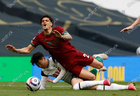 Tottenham's Son Heung-min and Wolverhampton Wanderers' Ki-Jana Hoever challenge for the ball during the English Premier League soccer match between Tottenham Hotspur and Wolverhampton Wanderers at Tottenham Hotspur Stadium in London, England