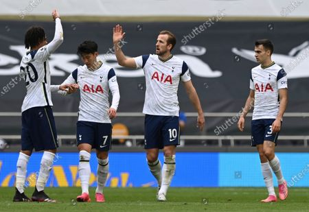 Tottenham's Harry Kane, center, celebrates after scoring his side's opening goal during the English Premier League soccer match between Tottenham Hotspur and Wolverhampton Wanderers at Tottenham Hotspur Stadium in London, England, . AP Photo/Shaun Botterill, Pool