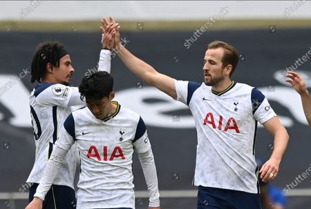 Tottenham's Harry Kane, right, celebrates after scoring his side's opening goal during the English Premier League soccer match between Tottenham Hotspur and Wolverhampton Wanderers at Tottenham Hotspur Stadium in London, England, . AP Photo/Shaun Botterill, Pool