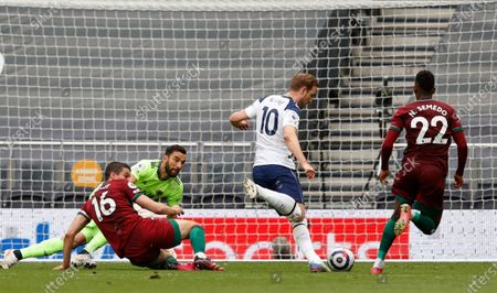Tottenham's Harry Kane, center, scores the opening goal during the English Premier League soccer match between Tottenham Hotspur and Wolverhampton Wanderers at Tottenham Hotspur Stadium in London, England