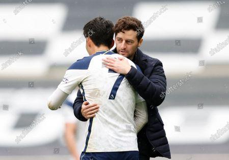Tottenham Hotspur's interim head coach Ryan Mason hugs Son Heung-min after the English Premier League soccer match between Tottenham Hotspur and Wolverhampton Wanderers at Tottenham Hotspur Stadium in London, England