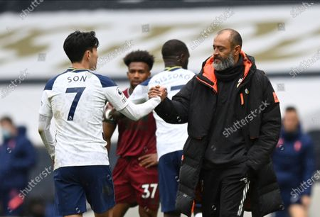 Tottenham Hotspur's Son Heung-min, left, and Wolverhampton Wanderers manager Nuno Espirito Santo after the English Premier League soccer match between Tottenham Hotspur and Wolverhampton Wanderers at Tottenham Hotspur Stadium in London, England
