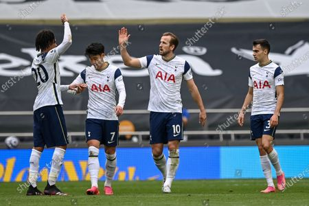 Harry Kane (2-R) of Tottenham celebrates with teammates after scoring a goal during the English Premier League soccer match between Tottenham Hotspur and Wolverhampton Wanderers in London, Britain, 16 May 2021.