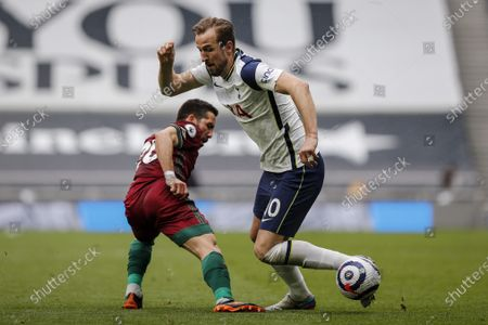 Harry Kane (R) of Tottenham in action against Joao Moutinho (L) of Wolverhampton during the English Premier League soccer match between Tottenham Hotspur and Wolverhampton Wanderers in London, Britain, 16 May 2021.