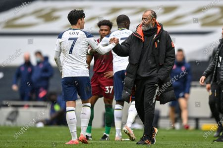 Wolverhampton Wanderers manager Nuno Espírito Santo (R) congratulates Son Heung-Min of Tottenham after the English Premier League soccer match between Tottenham Hotspur and Wolverhampton Wanderers in London, Britain, 16 May 2021.
