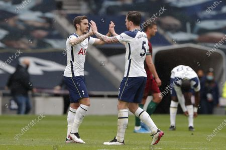 Harry Winks (L) and Pierre-Emile Hojbjerg (R) of Tottenham celebrate after the English Premier League soccer match between Tottenham Hotspur and Wolverhampton Wanderers in London, Britain, 16 May 2021.