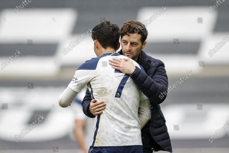 Tottenham manager Ryan Mason (R) congratulates Son Heung-Min (L) after the English Premier League soccer match between Tottenham Hotspur and Wolverhampton Wanderers in London, Britain, 16 May 2021.