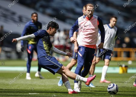 Son Heung-Min (L) and Harry Kane (R) of Tottenham warm up ahead of the English Premier League soccer match between Tottenham Hotspur and Wolverhampton Wanderers in London, Britain, 16 May 2021.