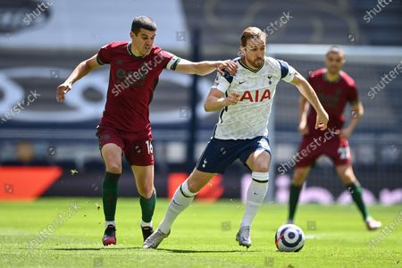 Harry Kane (R) of Tottenham in action against Conor Coady (L) of Wolverhampton during the English Premier League soccer match between Tottenham Hotspur and Wolverhampton Wanderers in London, Britain, 16 May 2021.