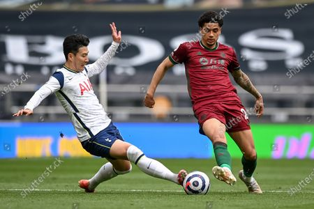 Son Heung-Min (L) of Tottenham in action against Ki-Jana Hoever (R) of Wolverhampton during the English Premier League soccer match between Tottenham Hotspur and Wolverhampton Wanderers in London, Britain, 16 May 2021.