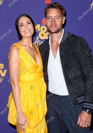 Stock Image of Mandy Moore and Justin Hartley