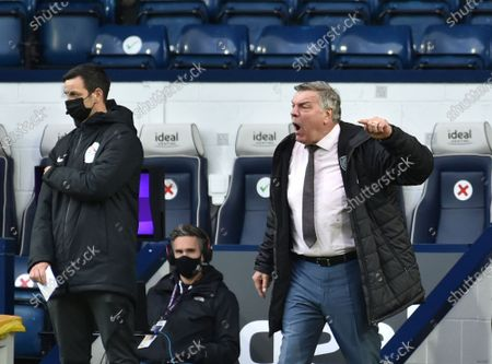 West Bromwich Albion's manager Sam Allardyce, right, reacts during the English Premier League soccer match between West Bromwich Albion and Liverpool at the Hawthorns stadium in West Bromwich, England